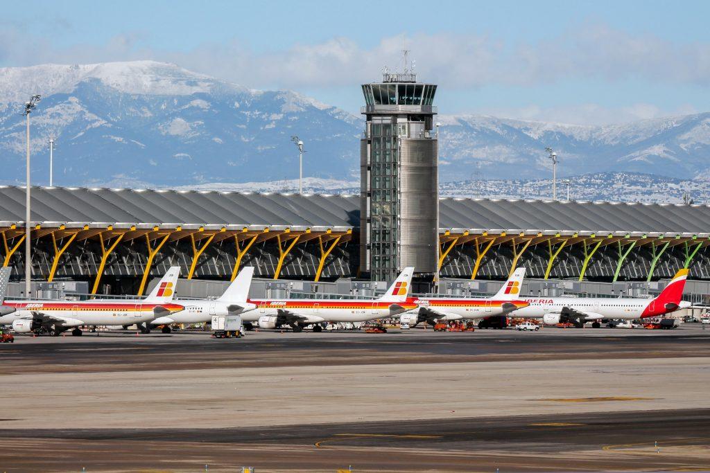 EEP9NR Iberia aircraft begin boarding on Terminal 4 at Madrid airport.